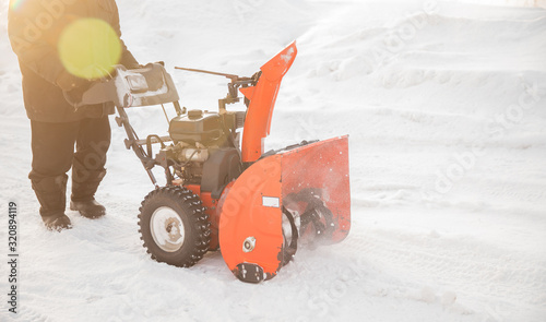 City service cleaning snow winter with thrower blower machine after snowstorm ya Canvas Print