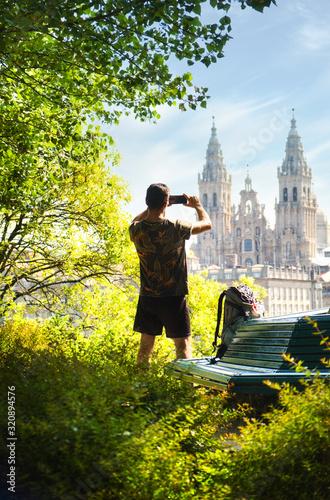 Young Pilgrim Taking Photo Of Church In Santiago De Compostela Fototapete