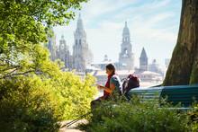 Tourist Woman On Pilgrimage At Santiago De Compostela With Phone