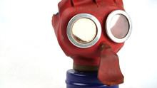 British WW2 Child's 'Mickey Mouse' Gas Mask And It's Box. These Were Issued To All UK Toddlers, The Bright Colours Were Designed To Help Turn Using The Mask Into A Game To Keep The Child Calm