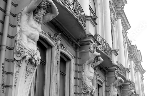 Statues of Atlantes, part of the decoration of an ancient building Canvas Print