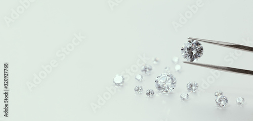 brilliant cut diamond held by tweezers Canvas Print