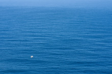 Small Boat On A Vast Open Ocea...