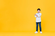 Smiling Asian Boy Doing Arms Crossed Gesture With Open Palm