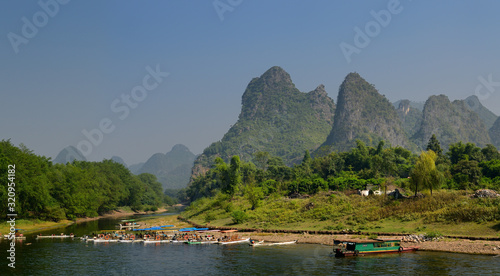 Fotografija Tour boat rafts on the shore of the Li river Guangxi China with karst mountain p