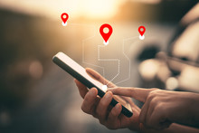 Man Hand Using Smartphone With Gps Navigator Map Icon On Blur Street Background.
