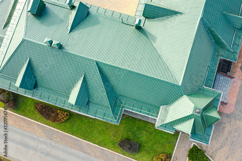 Stampa su Tela aerial top down photo of green tiled metal sloping roof with dormer windows