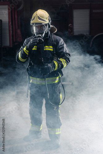 Portrait of a fireman wearing firefighter turnouts and helmet Canvas Print
