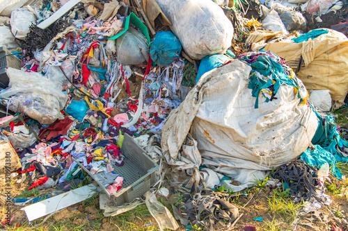 Fotografie, Obraz dump garbage background waste trash plastic and clothes global pollution ecologi