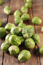 Raw Brussels Sprouts On Wood B...