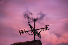Weather Vane Spinning In Strong Wind