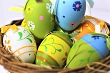 Easter Eggs In Basket On White Background