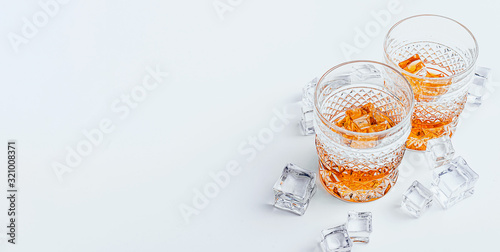 two glasses of whiskey with ice on a white background with place for text Poster Mural XXL