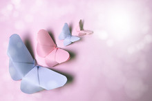 Pink And Violet Origami Butterflies Of Different Sizes On Isolated Pink Background With Sparkles And Vintage Air.Card Or Postcard To Dedicate To Mother, Woman, Working Woman, Birthday, Spring.