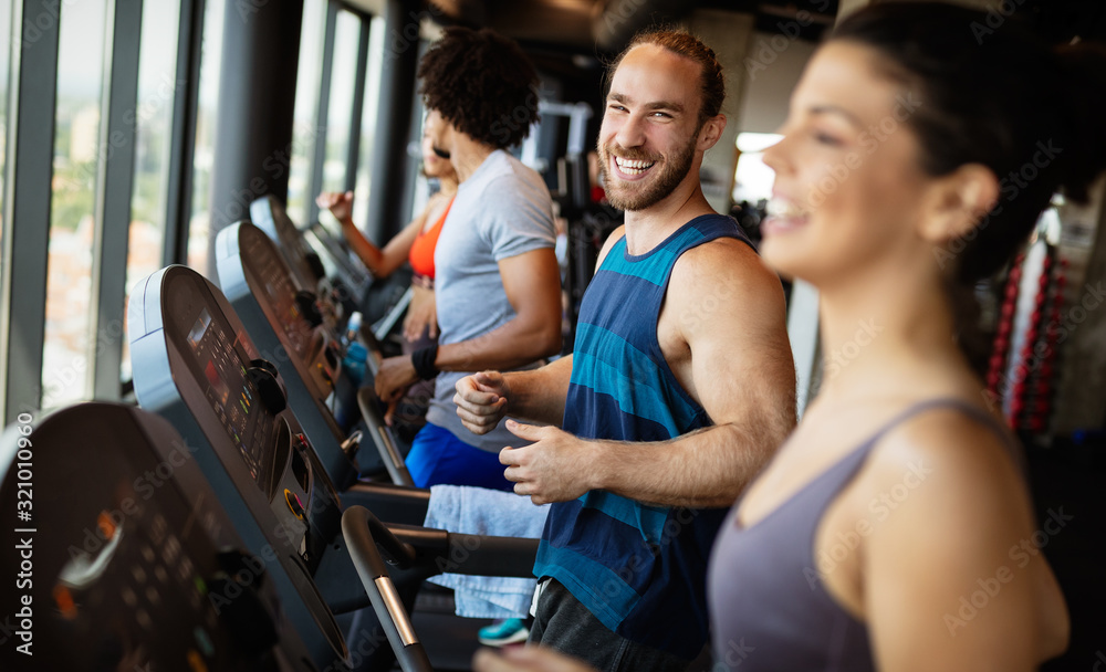 Fototapeta Picture of people running on treadmill in gym