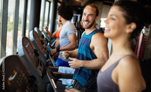 Picture of people running on treadmill in gym Fototapete
