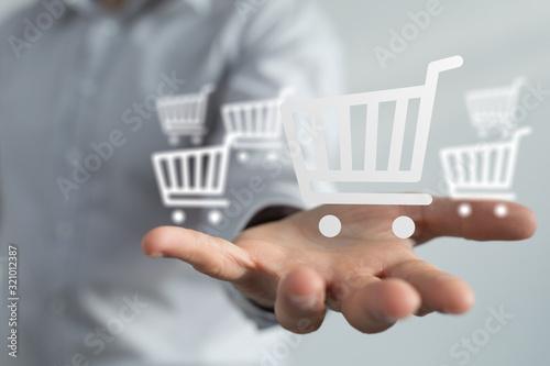 Fototapeta Businessman pressing modern technology panel shopping cart web phone credit card. obraz