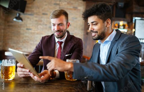 Handsome two businessmen have a meeting in a restaurant Wallpaper Mural