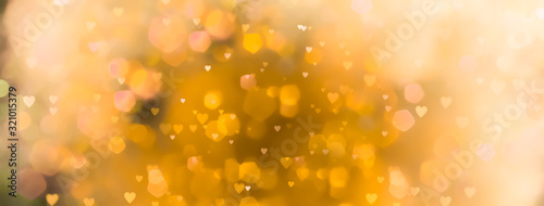 abstract-yellow-background-with-bokeh-lights-and-many-hearts-love-spring-summer-easter