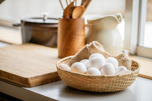 Chicken Eggs In Basket On Table.