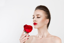 Beautiful MoThan Smell Perfume Aroma. Beautiful Model Woman Smelling Kissing Red Rose Flower. Sexy Red Lipsdel Woman Kissing Red Rose Flower. Sexy Red Lips