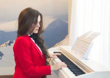 Young Beautiful Woman Playing ...
