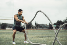 Man Doing Workout Using Battle Ropes On The Ground