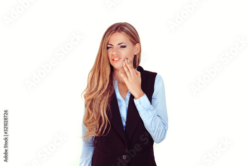 Valokuva Woman with sensitive toothache crown problem suffering from pain touching outside mouth with hand isolated on white background