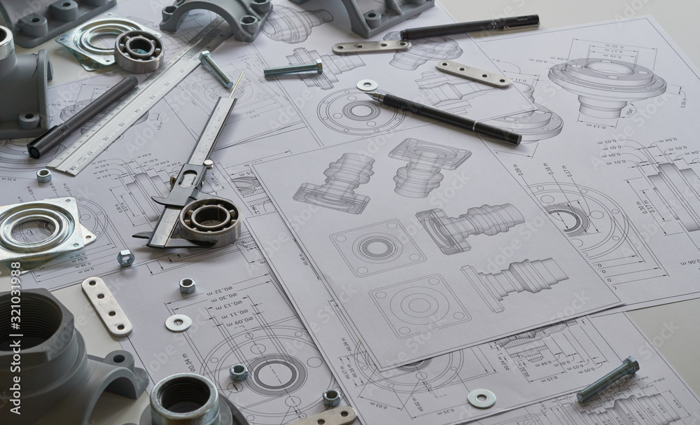 Fototapeta Engineer technician designing drawings mechanicalparts engineering Engine.manufacturing factory Industry Industrial work project blueprints measuring bearings caliper tools