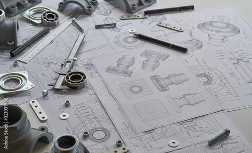 Engineer technician designing drawings mechanicalparts engineering Engine Fototapet