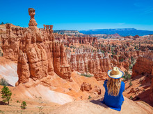 Young Woman Travels Bryce Canyon National Park In Utah, United States, People Travel Explore Nature. Bryce Is A Collection Of Giant Natural Amphitheaters Distinctive Due Hoodoos Geological Structures