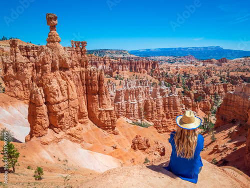 Young woman travels Bryce Canyon national park in Utah, United States, people travel explore nature Fotobehang