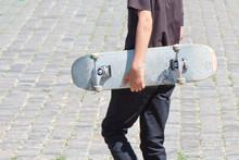 Shabby Skateboard In Hand Of G...