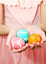 Little Girl Holding Handmade Painted Easter Eggs