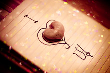 Heart Rock On Top Of Paper Wit...