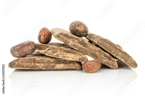 Group of four whole fresh brown cocoa bean with cocoa butter isolated on white b Canvas Print