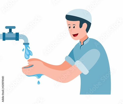 Fotografia, Obraz muslim man doing ablution, boy take water to washing hand