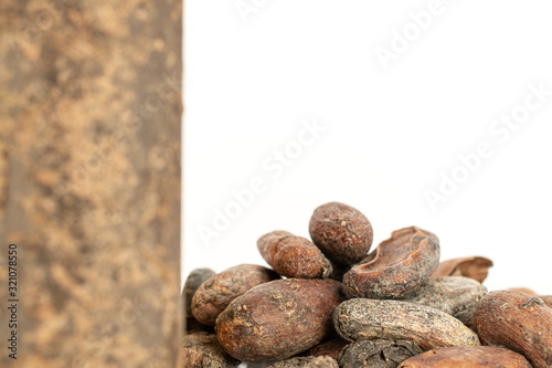 Lot of whole fresh brown cocoa bean back focus with cocoa butter isolated on whi Canvas Print