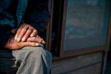 Old Man's Hands Sitting At Porch