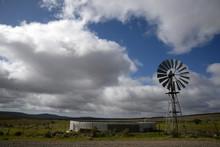 A Windmill Alongside A Water Tank