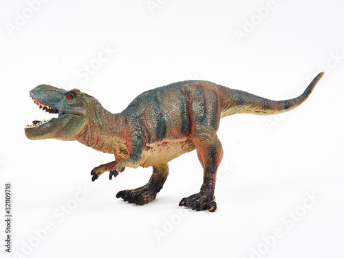Tyrannosaur rubber toy isolated on white