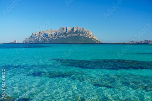 Clear water of sardinian beachs with view on Tavolara island Canvas Print