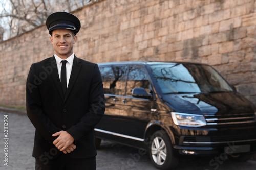 Professional driver near luxury car on street. Chauffeur service Canvas Print