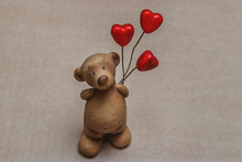 A Cute Clay Teddy Bear Holding...