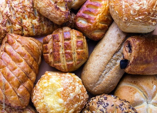 Fototapeta Puff pastries with and without filling and bakery products