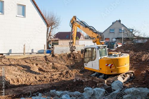 Hausbau, Ausheben einer Baugrube mit Bagger Tapéta, Fotótapéta