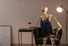 Skeleton In Dress With Wine Si...