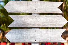 Wooden Signpost On A Backgroun...