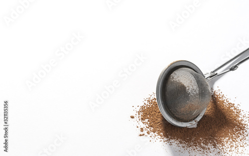 Valokuva Stainless steel strainer on Chocolate powder isolated on white background with c