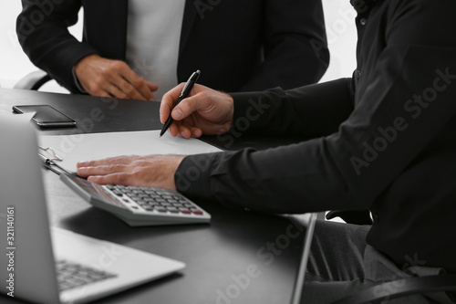 Photo Bank manager working with client in office